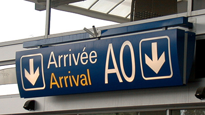 Image of airport arrival sign